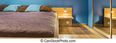 Bedroom in blue and brown
