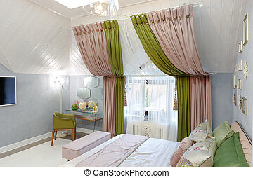 Bedroom in bright colors. On the window are green-pink curtains.