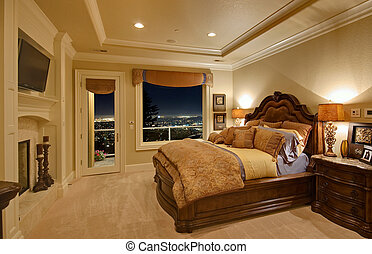 bedroom in new home with view of city at night