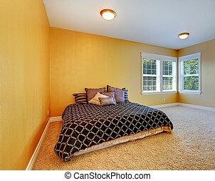 Bedroom interior in bright yellow color