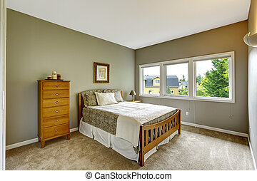 Bedroom interior in grey color with wooden furniture