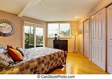 Bedroom interior in purple tones with wardrobe