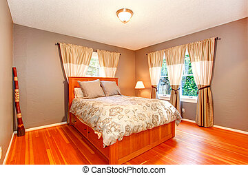 Bedroom interior in soft mocha with bright bed