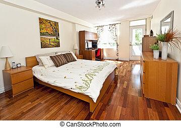 Bedroom interior with hardwood floor - artwork is from ...