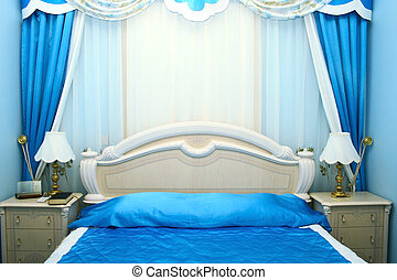Bedroom - Blue bedroom with luxurious curtains.