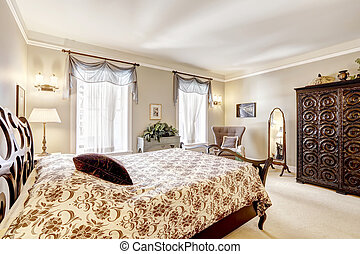 Bedroom with beautiful carved wood furniture
