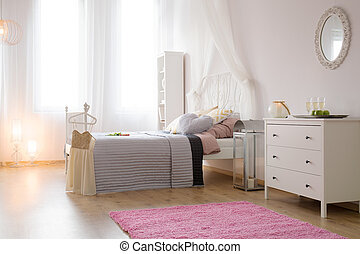 Bedroom with bed and carpet