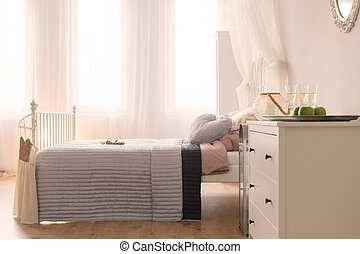 Bedroom with bed and dresser