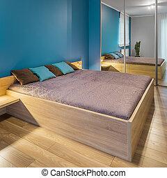 Bedroom with big wooden bed