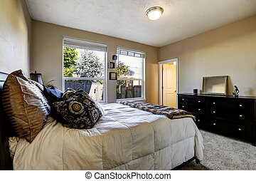 Bedroom with black dresser