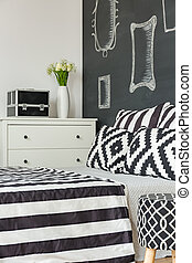 Bedroom with black wall