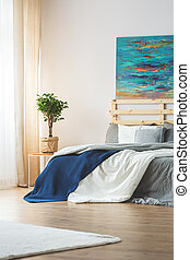 Bedroom with blue painting