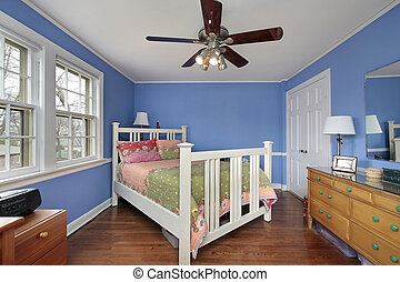Bedroom with blue walls - Bedroom in suburban home with blue...