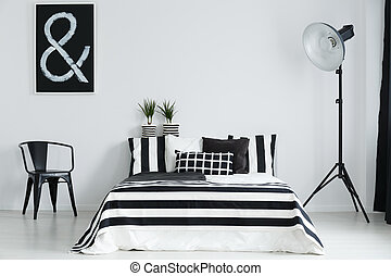 Bedroom with chair and lamp - Stylish, elegant bedroom with...