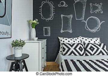 Bedroom with chalkboard wall