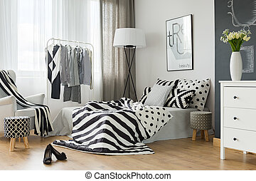Bedroom with clothes rack - Woman bedroom with clothes rack,...