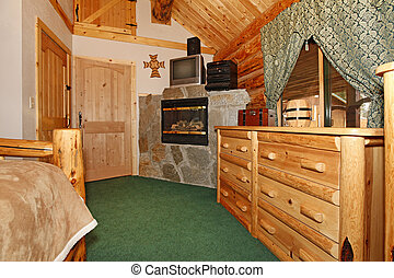 Bedroom with fireplace and wood doors