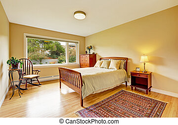 Bedroom with hardwood floor, bright walls