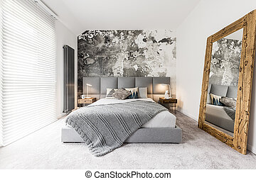 Bedroom with large wooden mirror - King-size bed with gray...