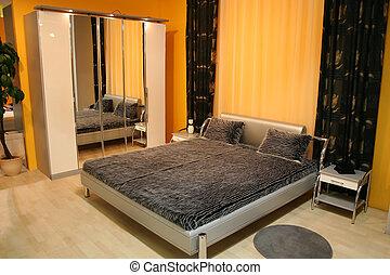 bedroom with mirror closet