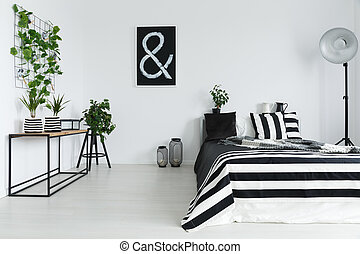Bedroom with plants - Elegant, black and white bedroom with...