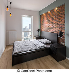 Bedroom with red, brick wall