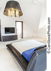 Bedroom with white floor covering