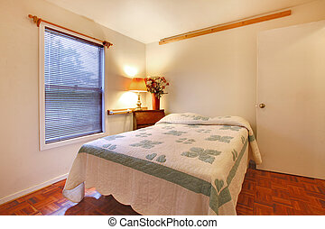 Bedroom with white walls and cherry hardwood floor