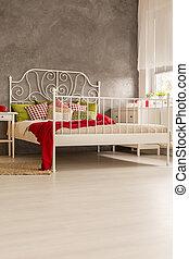 Bedroom with wood floor panels