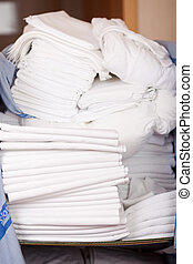 Closeup of bedsheets stacked in store room of hotel
