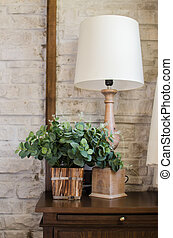Bedside lamp and green plant in bedroom - Bedside lamp and ...