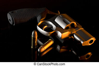 Bedside revolver - Handgun on a glass bedstand with orange...