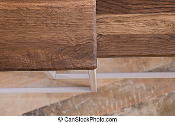 Bedside wooden table in loft style in a room of wood