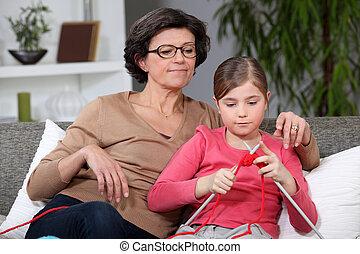 bedstemoderen, granddaughter, strikkearbejde