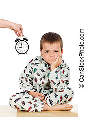 Bedtime for a displeased kid in pajamas - isolated