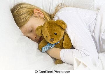 Bedtime - Little blond girl wearing white blouse in white ...