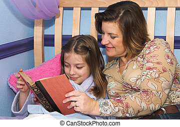 Bedtime Stories - a mother and daughter reading bedtime...