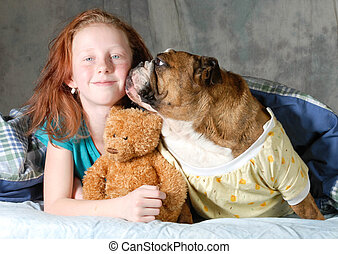 bedtime  - young girl in bed with her english bulldog