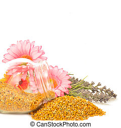 Bee pollen in glass jar and flowers copy space for text
