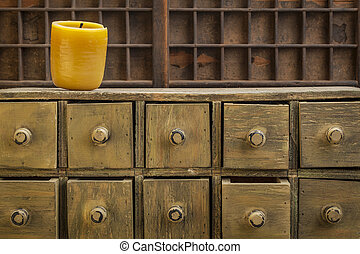 bee wax candle in retro setting with a primitive apothecary...