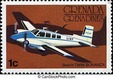 Beech Twin Bonanza - GRENADA - CIRCA 1976: A stamp printed...