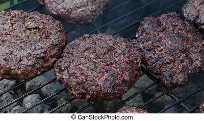 Beef burger for hamburger on barbecue flame grill - Close up...