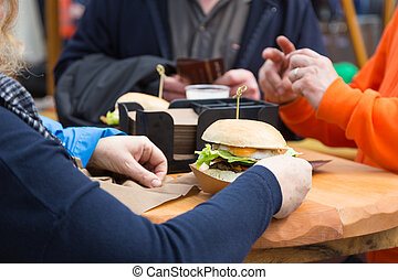 Beef burgers being served on street food stall