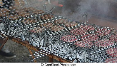 beef burgers cooked on the grill