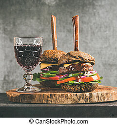 Beef burgers with barbeque sauce and red wine, square crop