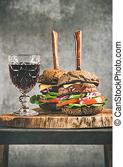 Beef burgers with barbeque sauce and red wine, vertical composition