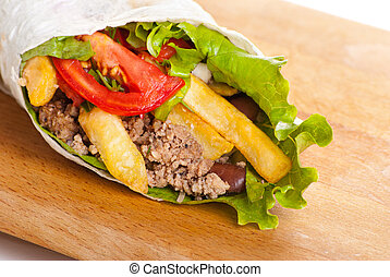 beef burrito with peppers, fried potato and tomato - beef...