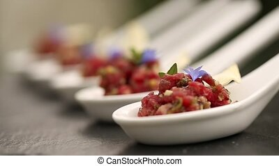 Beef carpaccio appetizer dish, sliced raw beef with olive...