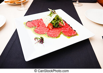 Beef carpaccio with salad