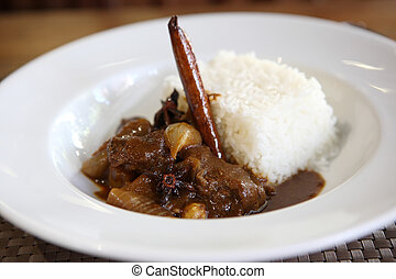 Beef curry with rice , Thai food on wood background